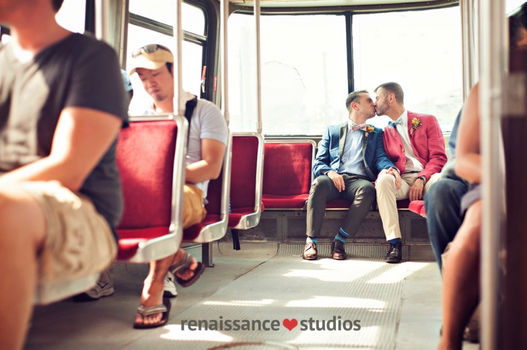 Gay couple riding streetcar on their wedding day