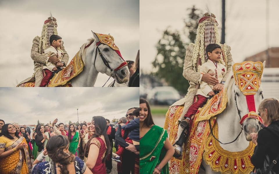 groom arrives on a horse with ring barer at indian wedding