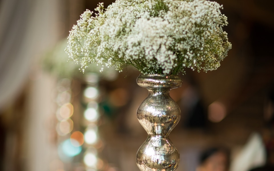 metallic floral centrepiece at wedding