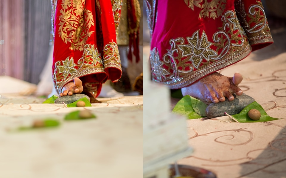 bride steps on rocks and leaves at indian wedding