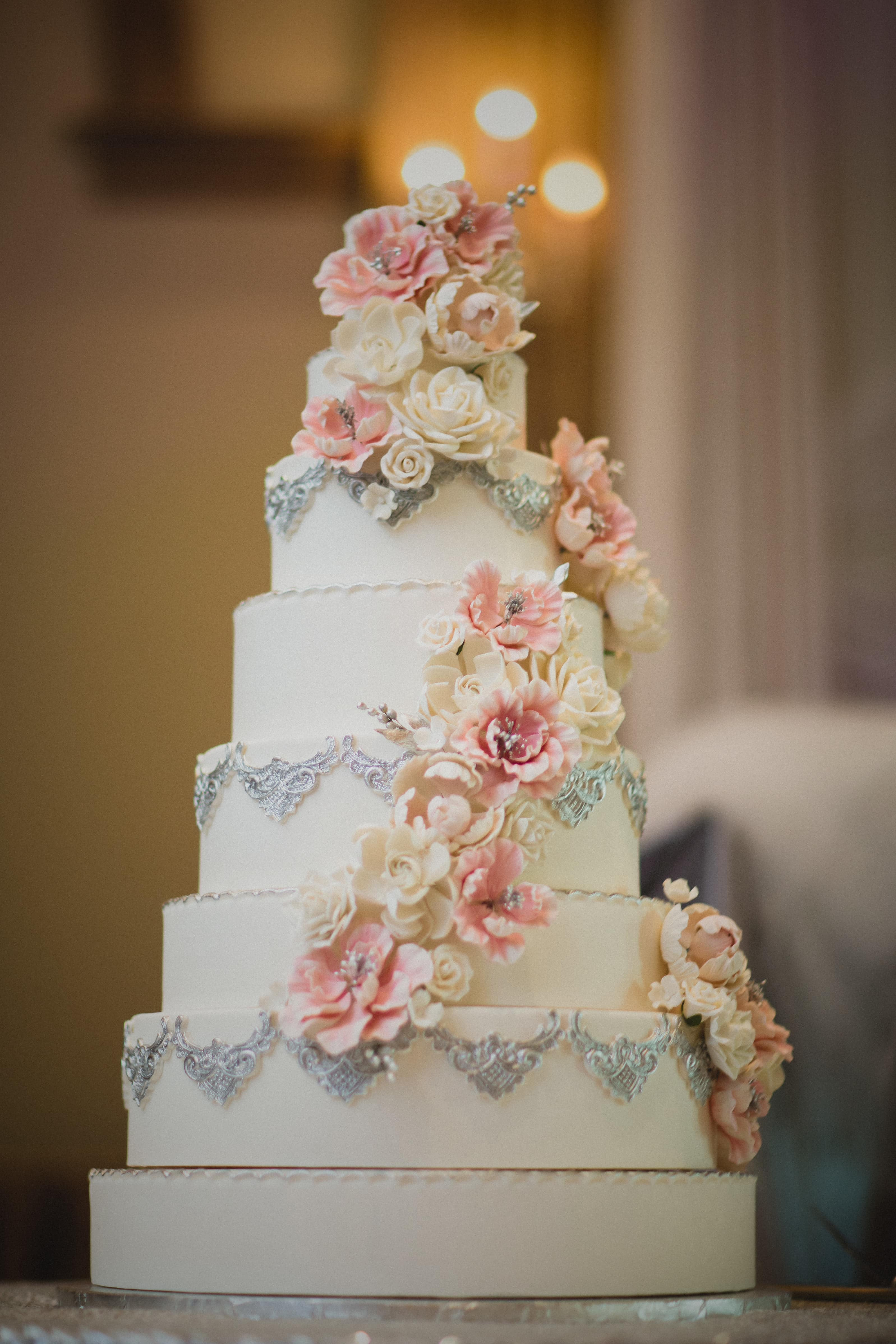 wedding cake with floral and lace design