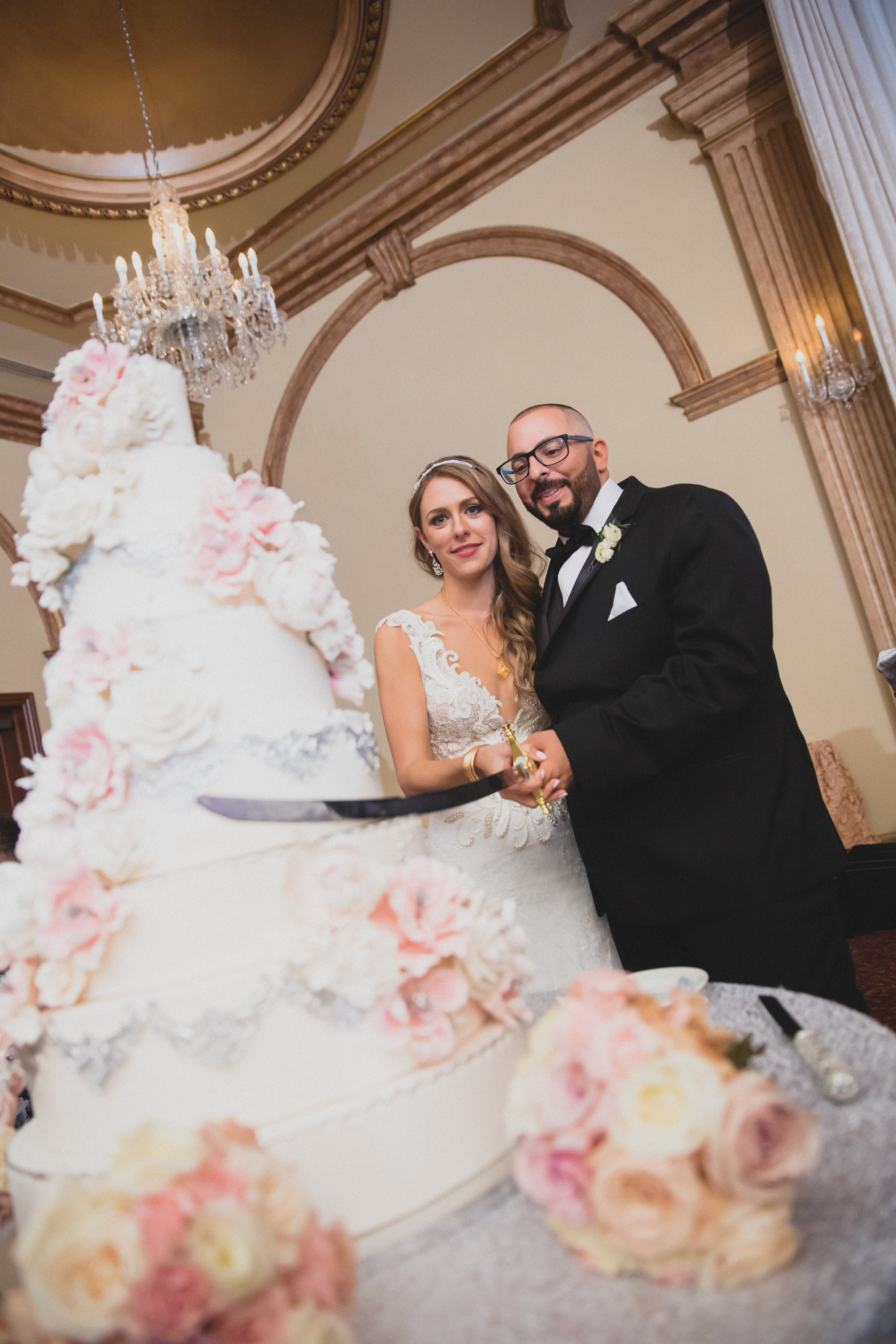bride and groom cutting a huge cake