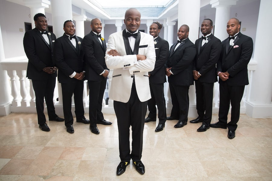 groom with his wedding party in tuxedos