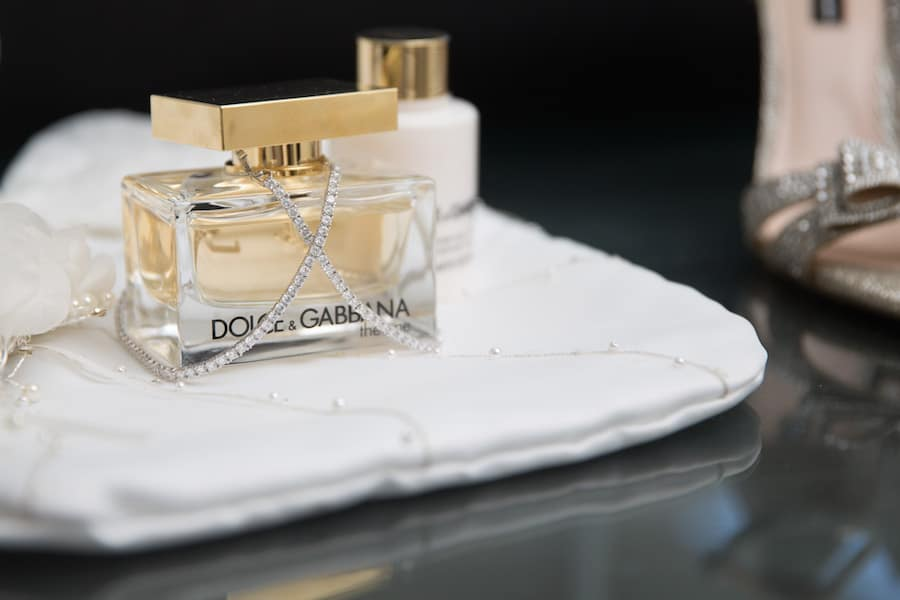 dolce and gabbana the one perfume at the wedding with crystal bracelets adorning the perfume