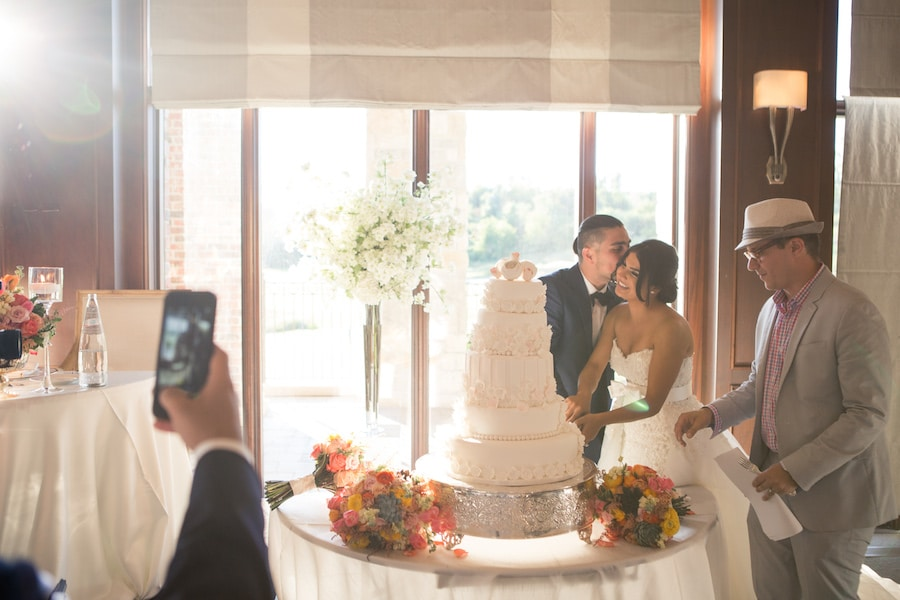 bride and groom cutting their cake