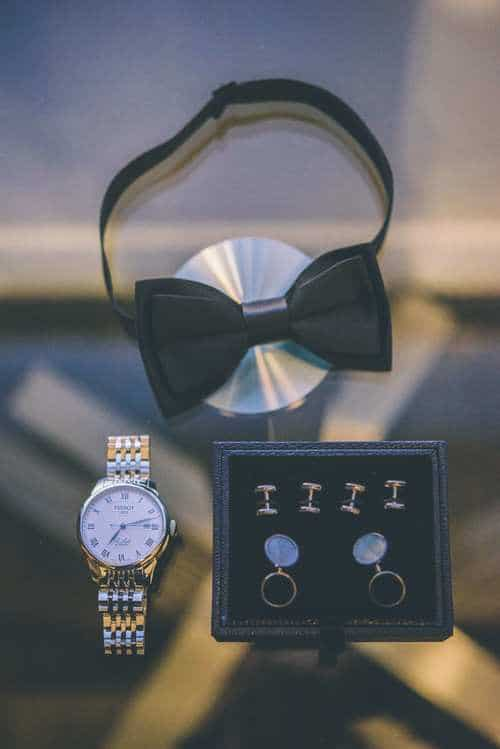 groom's bow tie, watch and cufflinks