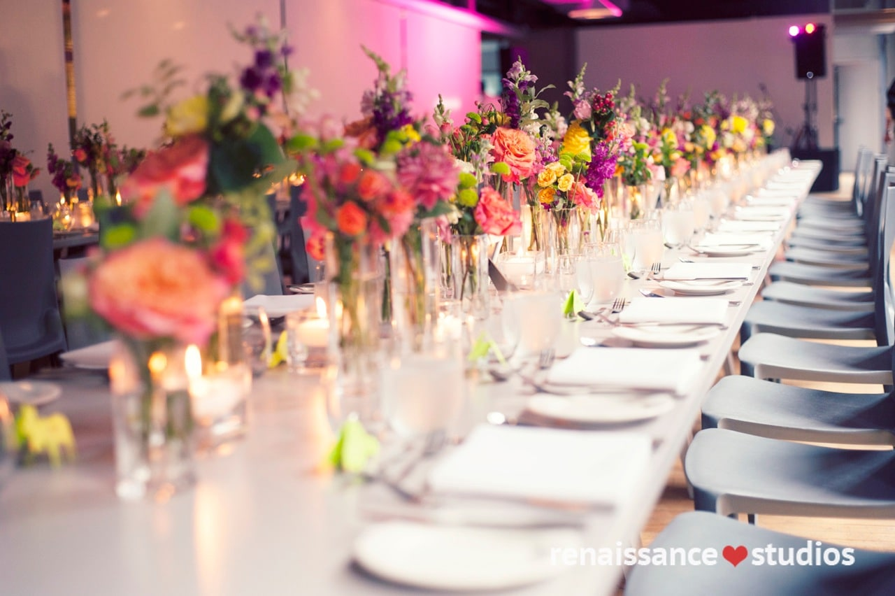 Colourful centrepiece design at rectangular table shot by renaissance studios