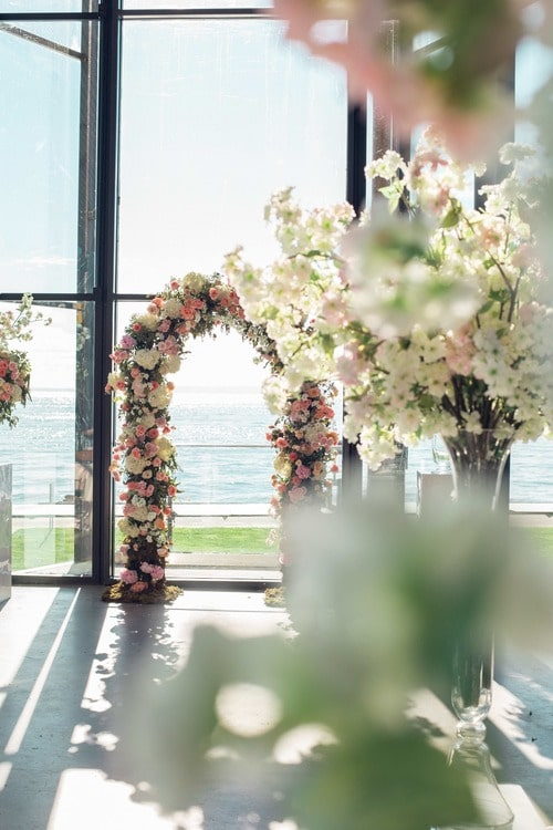 wedding ceremony arch with floral accents