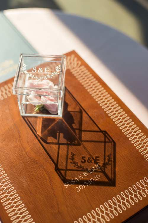 pink rose in glass box as a wedding accessory