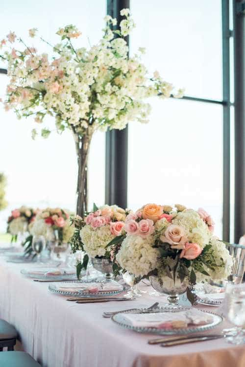 white, pink and orange rose and hydrangea centrepiece