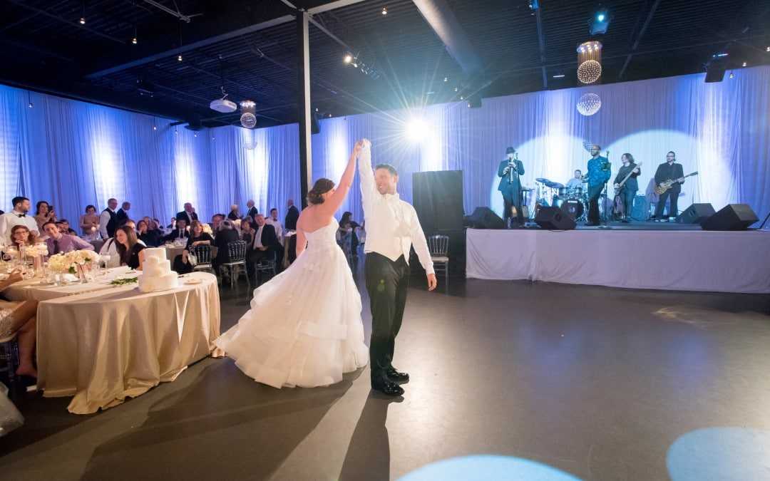 bride and groom dance to live wedding band in Torotno