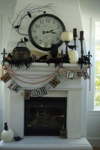 Fireplace mantle decorated in Halloween decor