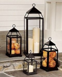 Lanterns with candles and small pumpkins
