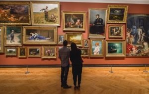 Couple looking at art inside AGO