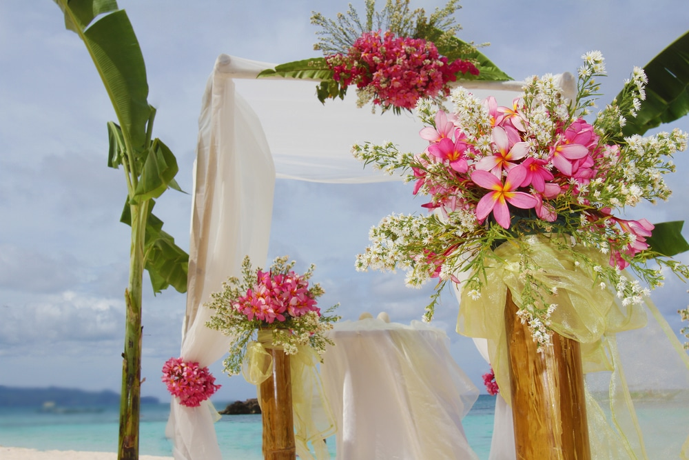outdoor wedding arch with flowers