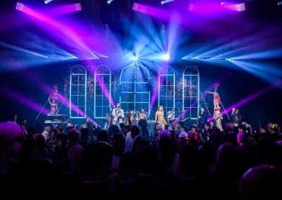 corporate events band urequest live playing in las vegas to large crowd with amazing lighting